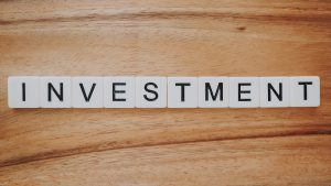 scrabble letters spelling investment