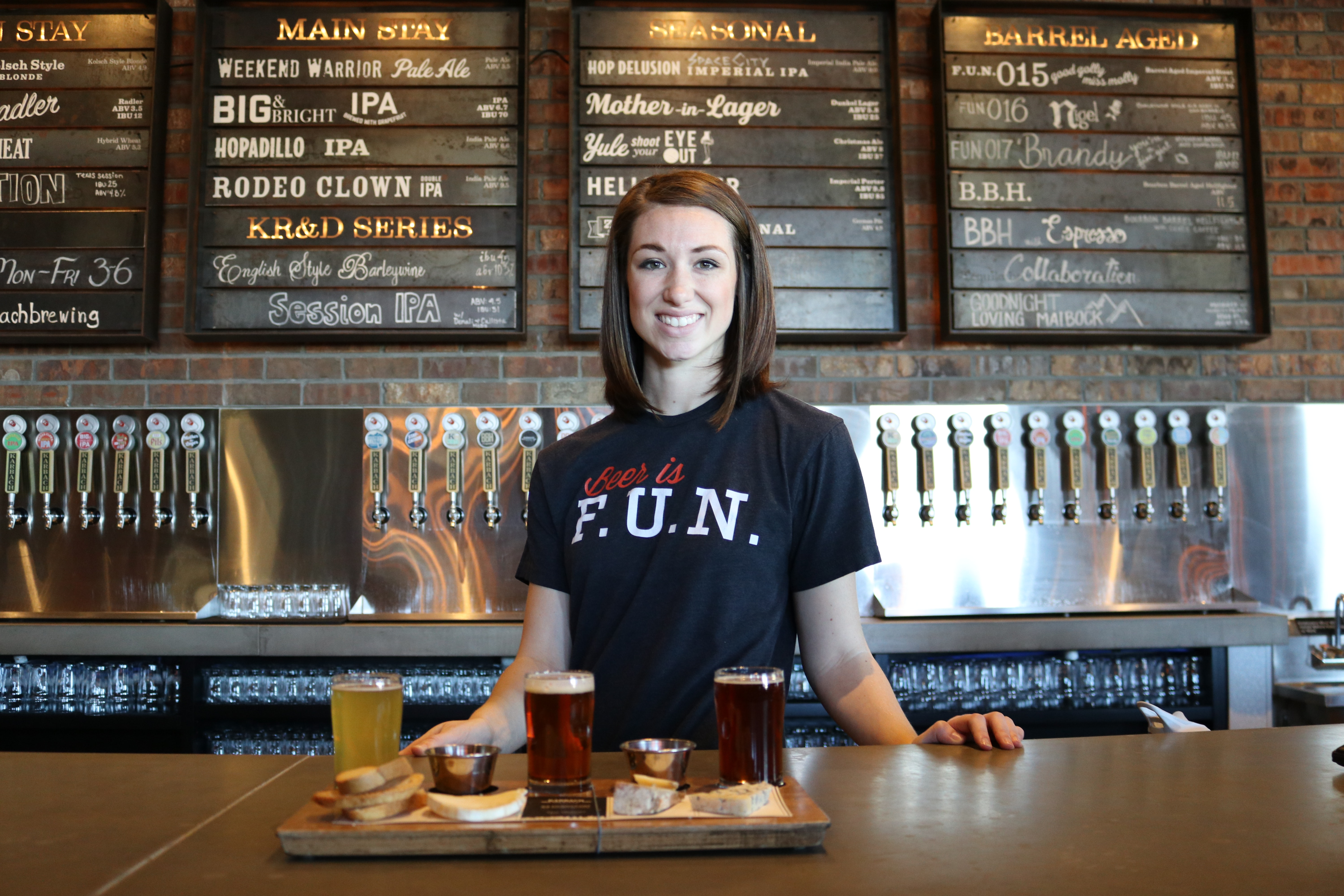 female bartender with food and drinks
