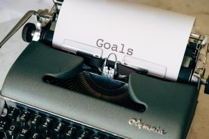 typewriter with goals typed on a piece of paper